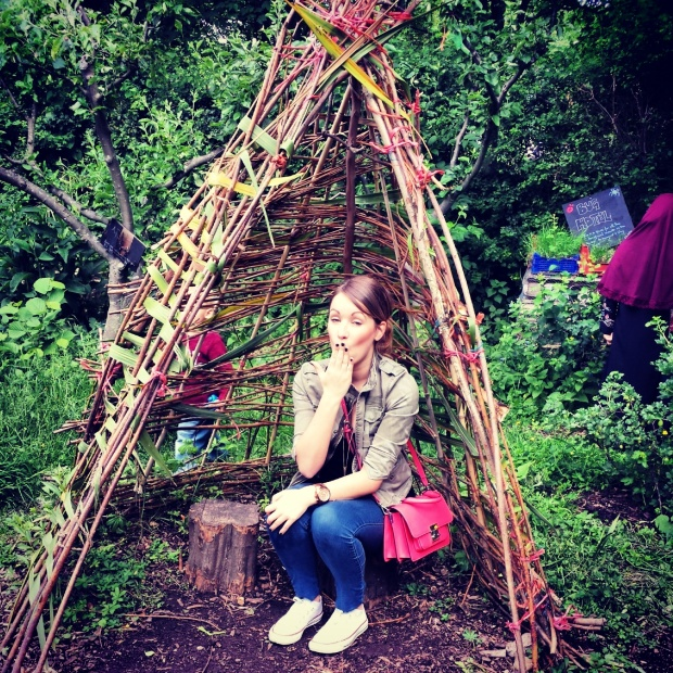 girl-sat-in-wooden-teepee