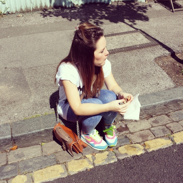 girl-sitting-on-kerb