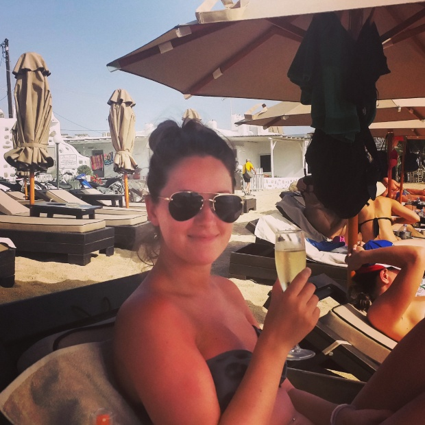 girl-with-champagne-on-beach