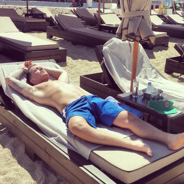 man-sunbathing-on-lounger